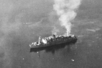 The Oryoku Maru under attack at Olongapo, Luzon, 14-15 December 1944.